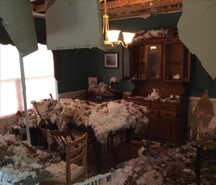 This is a photo of after the insulation and drywall feel into the dining room from a tree falling on the home.